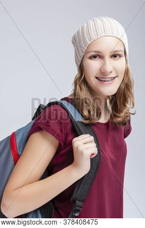Teenage Medical Ideas. Portrait Of Caucasian Teenager Girl Wearing Teeth Brackets. Posing With Backp