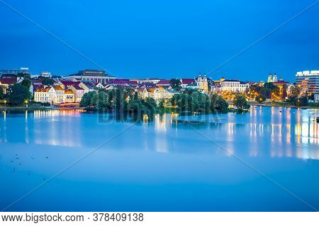 Belarus Travel Destinations. Minsk City View With Trinity Suburb And Svisloch River In At Twilight.