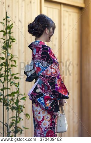 Asian Destinations. Young Female Geisha In Traditional Japanese Kimono In Kyoto City,  Japan. Vertic