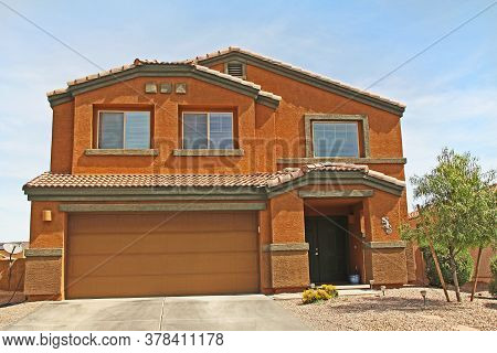 :  New Two-story, Tan Brown And Terra Cotta Orange Stucco Home In Tucson, Arizona, Usa With Beautifu