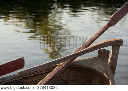 Oar And Keel Behind An Old Church Boat