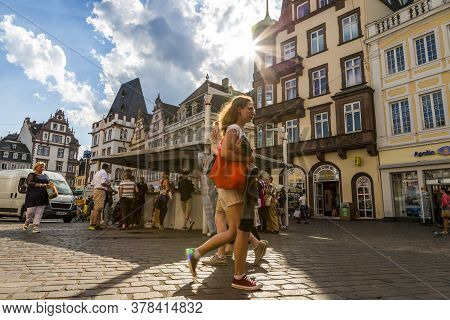 Trier, Germany - July 06, 2018: People Rest In The Central Square Of Trier
