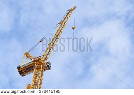 Construction Site With Cranes On Sky Background. Big Yellow Machinery Construction Crane Tool Of Bui