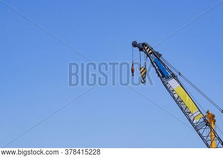 Construction Site With Cranes On Sky Background. Big Blue Machinery Construction Crane Tool Of Build