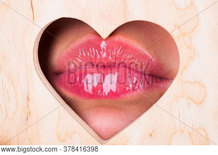 Heart Shape. Girl Natural Beauty Lips. Red Lip With Glossy Lipgloss. Close Up, Macro With Beautiful