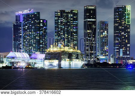 Miami Night Downtown. Cruise Ship In The Port Of Miami At Sunset With Multiple Luxury Yachts. Night