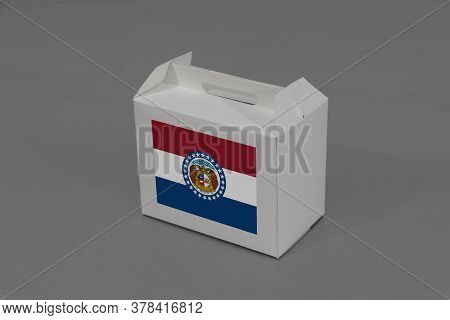 Missouri Flag On White Box On Grey Background. The Concept Of Export Trading From Missouri, Paper Pa