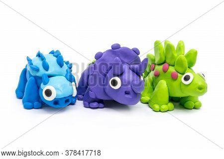 Play Dough Group Stegosaurus, Triceratopson, Ankylosaurus On White Background