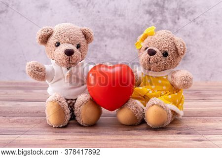 Couple Teddy Bear With Heart On Table Wooden. Valentine's Day Celebration
