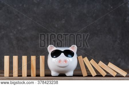 Financial Crisis. Stopping The Fall Of Finances Through Accumulation. Piggy Bank