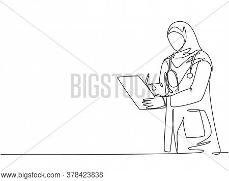 One Single Line Drawing Of Young Arabian Muslimah Doctor Wearing Hijab Writing Medical Report On Cli