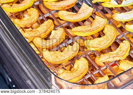 Sliced Apples In The Food Dryer. Cut Apples On Dehydrator Tray. Closeup, Selective Focus