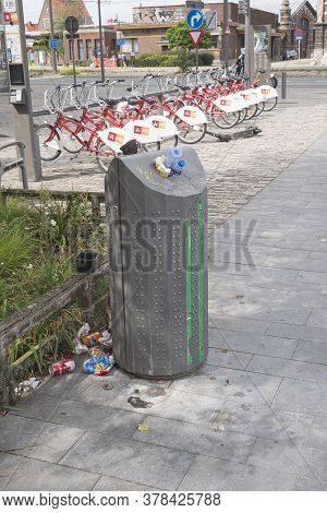 Antwerp, Belgium, July 19, 2020, Overflowing Garbage Bin At A Bicycle Shed