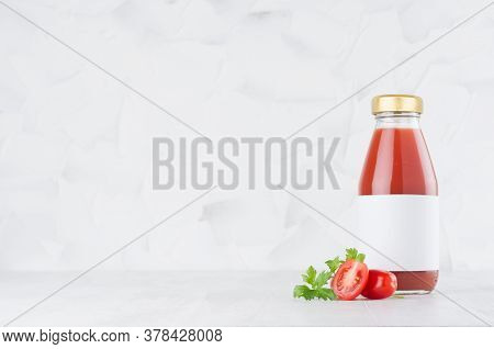 Fresh Red Tomato Juice In Glass Bottle With Blank Label Template With Green Parsley, Vegetables Slic