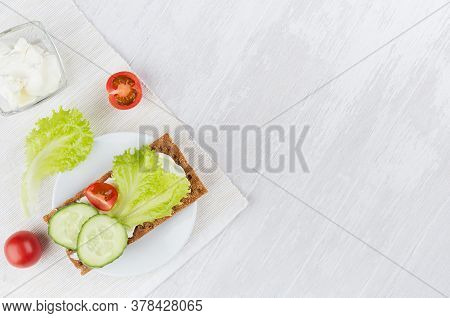 Cooking Of Fresh Light Summer Appetizer Of Crisps Bread, Green Salad, Cucumber, Tomato Cream Cheese