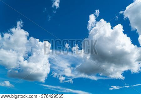 Beautiful White Fluffy Clouds Flowing                            On The Bright Sky In Sunny Day.