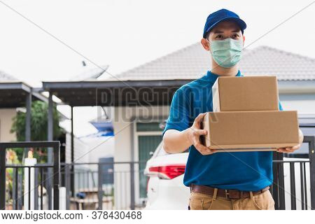 Asian Delivery Express Courier Young Man Giving Boxes To Woman Customer He Wearing Protective Face M