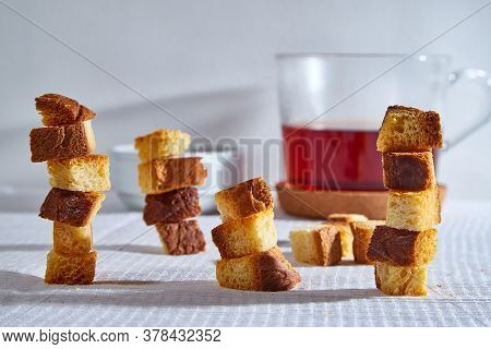Square Toasted Pieces Of Homemade Delicious Rusk, Hardtack, Dryasdust, Zwieback Stand In Columns On