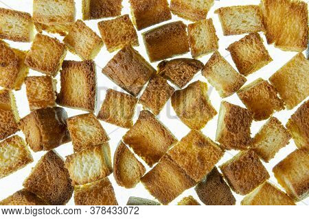 A Scattering Of Rusks On A White Background. White Bread Rusks.