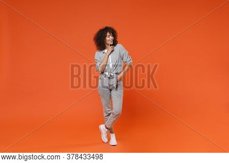 Smiling Young African American Woman Girl In Gray Casual Clothes Posing Isolated On Orange Backgroun