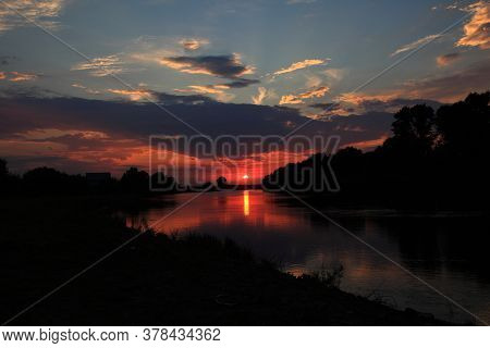 Sunset In The Delta Of The Volga River On The River Baklanya. The Astrakhan Region. Russia. Blurred