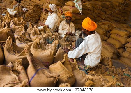 Sikh Men Packing Sacks Grain Charity Gurudwara