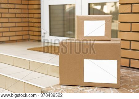 Delivered Parcels On Porch Near Front Door