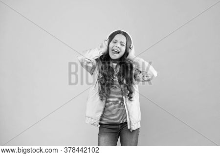 Joining In A Song. Small Girl Sing To Song Pink Background. Little Child Do Vocal On Song. Emotional