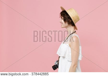 Side View Of Smiling Young Tourist Woman In Summer White Dress Hat With Photo Camera Isolated On Pin