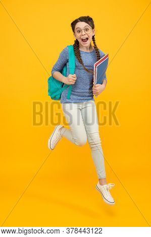 There Is Time For Study And Fun. Happy Kid Jump Yellow Background. Enjoying Holidays. School Holiday
