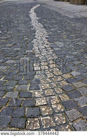 Golden Cobblestones In Viscardigasse Street In Munich - Germany