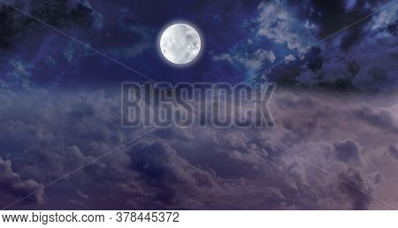 High Full Moon Night Time Cloudscape - Dark Blue Night Sky With A Bright Full Moon Centrally Placed