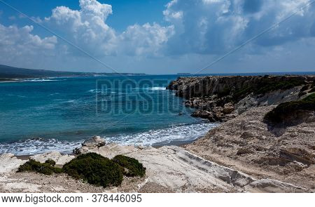 The Rocky Coast Of The Mediterranean Sea On The Akamas Peninsula In The Northwest Of The Island Of C
