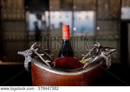 Wine Bottle In Ice Bucket. Wine Bottle In Bucket With Ice. Champagne Bottle In Ice Bucket