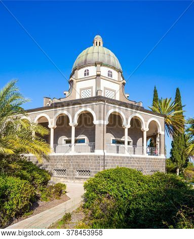 Catholic Church of the Beatitudes of the Franciscan monastery. The Mount Bliss on the Sea of Galilee. Israel. Blooming huge park around the monastery. The concept of religious pilgrimage