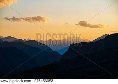 Colorful Dawn Landscape With Beautiful Blue Mountains Silhouettes And Golden Gradient Sky With Cloud