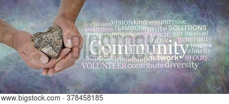 Care For Your Community Word Cloud - Male  Hands Holding A Wooden Rustic Heart With The Word Care Be