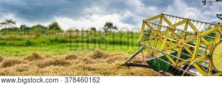 Combine Harvester Reel. Combine Getters Grain Crop On The Agricultural Field. Weather With Gloomy Sk