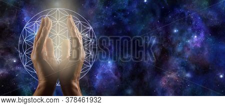 Cosmic Flower Of Life Prayer - Male Cupped Hands With White Light Between And A Flower Of Life Symbo