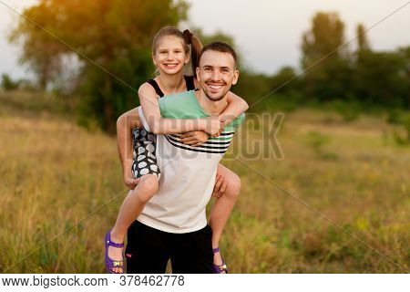 Beautiful Little Girl Hugging Embracing Her Father In Summer