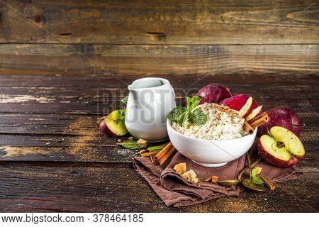 Hot Autumn Breakfast Or Lunch Porridge Or Pudding With Apple And Spices. Rice Porridge With Cinnamon