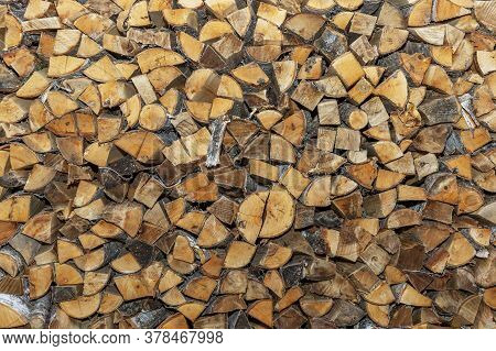Large Woodpile With Firewood. Background, Texture. Space For Text