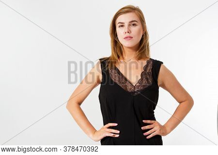 Beautiful Woman Model Posing In Elegant Dress In The Studio. Fashion Photo Of Beautiful Lady In Eleg