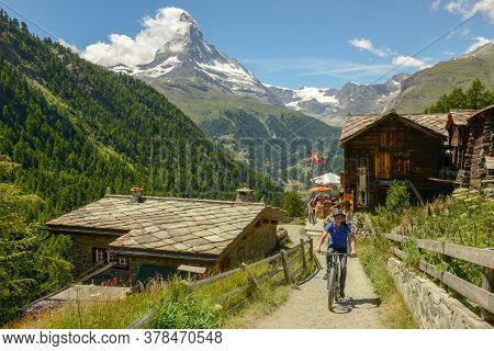 Man Driving A Mtb On A Trail At Zermatt On The Swiss Alps