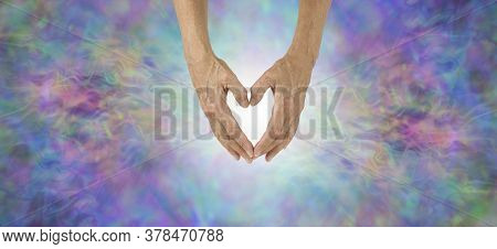 Love Heals Everything Concept Banner - Female Hands Making A Heart Shape With White Light Behind And