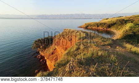 Panoramic View Of Orange Rocky Cliffs And Adriatic Sea. Island Vir In Croatia On Sunset.