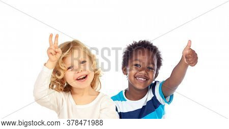 Happy classmates saying Ok with their thumbs up isolated on a white background