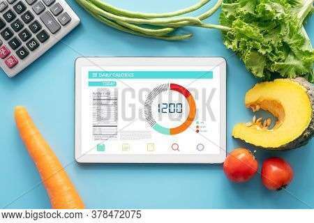 Calories Counting , Diet , Food Control And Weight Loss Concept. Tablet With Calorie Counter Applica