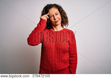 Middle age brunette woman wearing casual sweater standing over isolated white background worried and stressed about a problem with hand on forehead, nervous and anxious for crisis