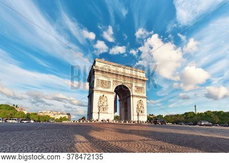 Arc De Triumph In Paris, France, On An Empty Square With Feather Clouds In Blue Sky Above, Panorama